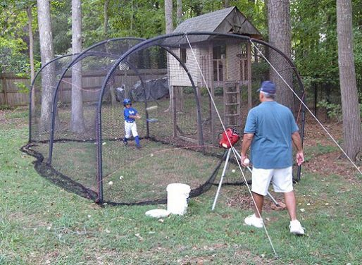 Xtender Batting Cage Shown From Behind Coach & Pitching Machine
