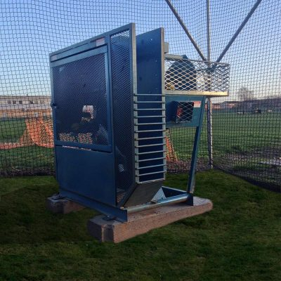 Iron Mike MP 4 Pitching Machine Front View Set On Concrete
