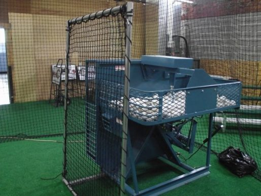 Iron Mike MP6 Pitching Machine Shown With Older Machine Guard
