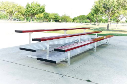 aluminum bleachers and double foot board shown in red team color