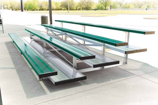 low rise bleachers in 4 row and double foot boards shown in forest green team color