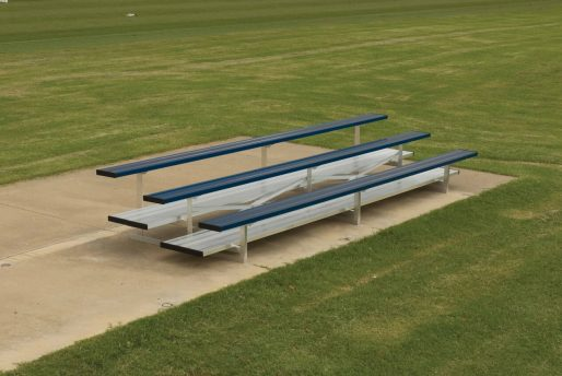 aluminum bleachers in 3 row and double foot boards in navy blue team color