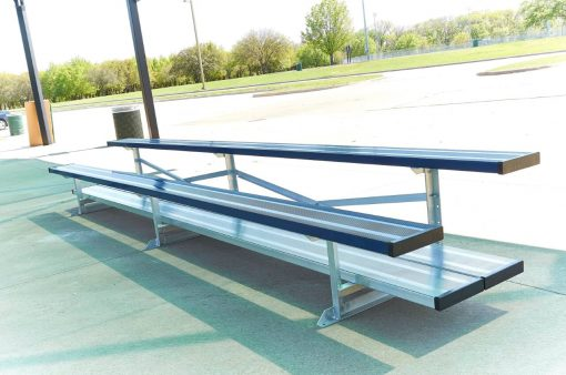 aluminum bleachers in 2 row and double foot boards in navy blue team color