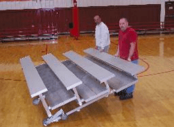 Tip and roll bleacher seating storage seating
